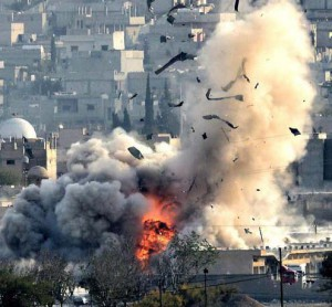An explosion after an US-led coalition airstrike on Kobane, Syria, as seen from the Turkish side of the border, near Suruc district, Sanliurfa, Turkey, 27 October 2014.   ANSA /ERDEM SAHIN
