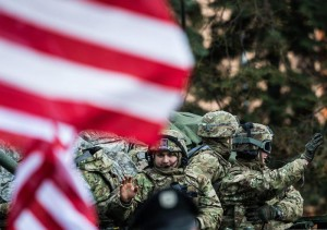 People wave US flags as soldiers on vehicles of the 'Dragoon Ride' US Army convoy wave while on their way to a Czech army barrack in Prague, Czech Republic, 30 March 2015. EPA/FILIP SINGER