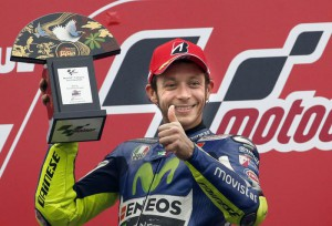 Second placed Valentino Rossi of Italy poses for photographers during the awarding ceremony of MotoGP Japanese Motorcycle Grand Prix at Twin Ring Motegi circuit in Motegi, north of Tokyo,  Sunday, Oct.  11, 2015. (ANSA/AP Photo/Shizuo Kambayashi)