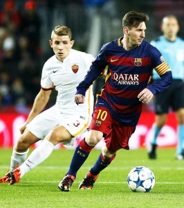 Barcelona's Argentinian striker Lionel Messi (R) in action against Roma's French defender Lucas Digne (L) during the UEFA Champions Leage Group E soccer match between FC Barcelona and AS Roma at Camp Nou in Barcelona, Spain, 24 November 2015.  EPA/ANDREU DALMAU
