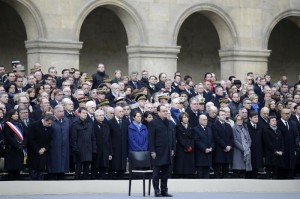 French President Francois Hollande, center, attends  a ceremony to honor the 130 victims killed in the Nov. 13 attacks in the courtyard of the Invalides in Paris, Friday, Nov. 27, 2015. (Philippe Wojazer/Pool Photo via AP)