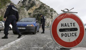 French customs control and check a car coming from Italy at the Franco-Italian border in Menton, southeastern France, Friday, Nov. 13, 2015. (ANSA/AP Photo/Lionel Cironneau)