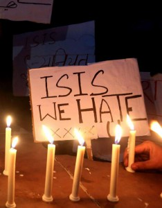 Indian Muslims and children hold candles and slogans against ISIS as they organize a candle light vigil for the victims of the deadly terrorist Paris attacks in Bhopal, India, 15 November 2015. EPA/SANJEEV GUPTA