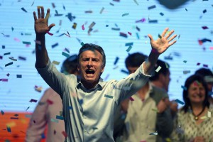 Argentinian presidential candidate Mauricio Macri (C) of the centre-right political coalition Cambiemos (Let's change) celebrates in front of supporters in Buenos Aires, Argentina, 25 October 2015. According to according to the polls, Macri came second in Argentina's presidential election, forcing a runoff against the ruling party of presidential candidate Daniel Scioli.  EPA/JUAN IGNACIO RONCORONI