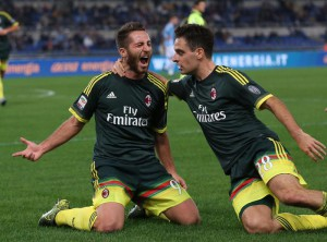 Milan's Andrea Bertolacci (L) jubilates with his teammate Giacomo Bonaventura (R) after scoring the goal (1-0) during the Italian Serie A soccer match SS Lazio vs AC Milan at Olimpico stadium in Rome, Italy, 01 November 2015.  ANSA/ALESSANDRO DI MEO