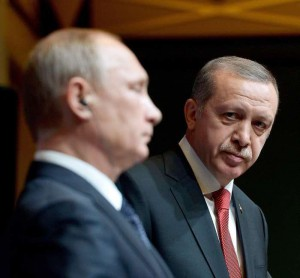 A handout picture provided by Turkish Presidential Press Office shows Russian President Vladimir Putin (L) and his Turkish counterpart Recep Tayyip Erdogan (R) attend a press conference in the new presidential palace in Ankara, Turkey, 01 December 2014.