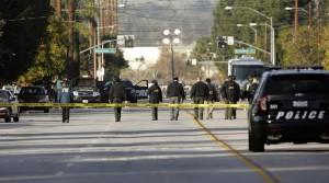 Investigators search for bullet casings at the scene where Wednesday's police shootout with suspects took place, Thursday, Dec. 3, 2015, in San Bernardino, Calif. A heavily armed man and woman dressed for battle opened fire on a holiday banquet for his co-workers Wednesday, killing multiple people and seriously wounding others in a precision assault, authorities said. Hours later, they died in a shootout with police.(ANSA/AP Photo/Jae C. Hong)
