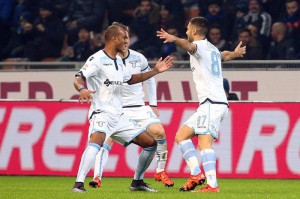 Lazio's midfielder Antonio Candreva (R) jubilates with his teammates  Abdoulay Konko (L) and Lucas Biglia (C) after scoring the goal of 0-1 during the Italian serie A soccer match between Fc Inter and Ss Lazio at Giuseppe Meazza stadium in Milan, Italy, 20 December 2015. ANSA / MATTEO BAZZI