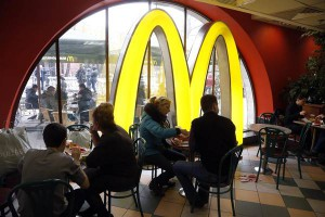 A file picture dated 04 April 2014 shows people dining at a McDonald's restaurant on Manezhnaya Square in Moscow, Russia.  EPA/MAXIM SHIPENKOV