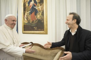 Handout image released by L'Osservatore Romano shows Italian actor Roberto Benigni (R) and Pope Francis during the presentation of the book ' The name of God is Mercy' (Il nome di Dio e' Misericordia), Rome, Italy, 12 January 2016. ANSA/ L'OSSERVATORE ROMANO