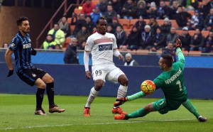 Carpi Fc forward Jerry Mbakogu ( c ) kicks against Fc Inter goalkeeper Samir Handanovic during the Italian serie A soccer match between Fc Inter and Carpi Fc at Giuseppe Meazza stadium in Milan, 24  January 2016.  ANSA / MATTEO BAZZI