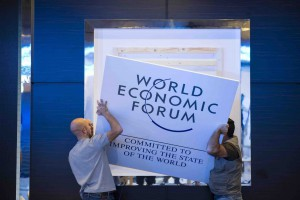 epa04033015 Workers make the last preparations inside the Congress Center, two days before the opening of the 44th Annual Meeting of the World Economic Forum (WEF), in Davos, Switzerland, 20 January 2014.  EPA/JEAN-CHRISTOPHE BOTT
