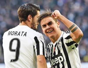 Argentinian forward Paulo Dybala of Juventus Fc (R) celebrates with teammates Alvaro Morata after scoring the 1-0 goal lead against Hellas Verona during Italian Serie A soccer match Juventus Fc-Hellas Verona at the Juventus Stadium, Turin, 6 January 2016.  ANSA / DI MARCO