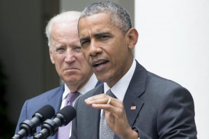 US President Barack Obama (R) delivers remarks on a ruling of the US Supreme Court regarding the Affordable Care Act, beside US Vice President Joe Biden (L), in the Rose Garden of the White House in Washington DC, USA, 25 June 2015. The Supreme Court ruled 6-3 that tax subsidies that help millions of Americans afford health insurance are legal, upholding a main tenet of the Affordable Care Act - also known as 'Obamacare'.  EPA/MICHAEL REYNOLDS