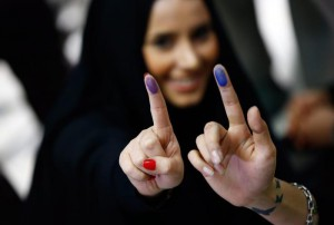 Iranians girls show the ink on their fingers, indicating they have voted, in the parliamentary and Experts Assembly election at a polling station at Ershad Mosque in Tehran, Iran, 26 February 2016. EPA/ABEDIN TAHERKENAREH  EPA/ABEDIN TAHERKENAREH