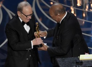 Quincy Jones, right, presents Ennio Morricone with the award for best original score for The Hateful Eight at the Oscars on Sunday, Feb. 28, 2016, at the Dolby Theatre in Los Angeles. (Photo by Chris Pizzello/Invision/ANSA/AP)