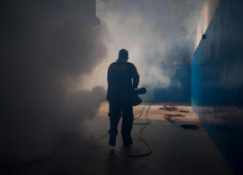 An employee of the muncipality of Chacao fumigates the hall of a school during efforts to prevent the possible spread of the Zika virus in the country, in Caracas, Venezuela, 05 February 2016.  ANSA/MIGUEL GUTIERREZ