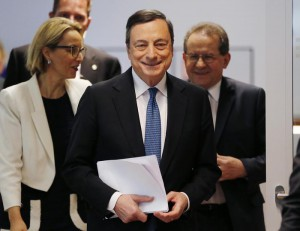 President of European Central Bank Mario Draghi  is on his way to a press conference following a meeting of the governing council in Frankfurt, Germany, Thursday, March 10, 2016.  The European Central Bank cut all its main interest rates, expanded its bond-buying stimulus program, and offered new cheap loans to banks, making an unexpectedly aggressive effort to boost inflation and economic growth in the 19 countries that share the euro.  (ANSA/AP Photo/Michael Probst)