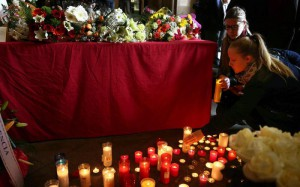 Students light candles and place flowers in memory of the victims of the coach crash at the historic headquarters of the University of Barcelona (UB), in Barcelona, northeastern Spain, 21 March 2016. EPA/TONI ALBIR