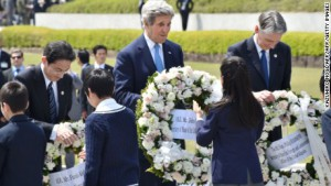 John Kerry, center, joins Japanese and British ministers in laying wreaths at Peace Memorial