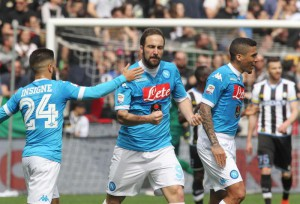 Napoli's Gonzalo Higuain (C) jubilates with his teammates Lorenzo Insigne (L) and Allan (R) after scoring the goal during the Italian Serie A soccer match Udinese Calcio vs SSC Napoli at Friuli stadium in Udine, Italy, 03 April 2016. ANSA/LANCIA