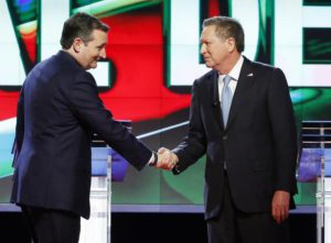 Republican presidential candidate, Sen. Ted Cruz, R-Texas, left, shakes hands with Republican presidential candidate, Ohio Gov. John Kasich, at the start of the Republican presidential debate sponsored by CNN, Salem Media Group and the Washington Times at the University of Miami,  Thursday, March 10, 2016, in Coral Gables, Fla. (ANSA/AP Photo/Wilfredo Lee)