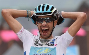 Italian rider Fabio Aru of the Astana Pro team celebrates as he crosses the finish line to win the 20th stage of the 98th Giro d'Italia