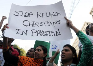 Pakistani Christian women hold a banner during a protest one day after Lahore churches attack, in Karachi