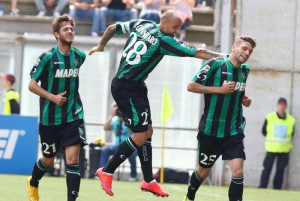 Sassuolo's Domenico Berardi (R) jubilates with his teammates after scoring the goal