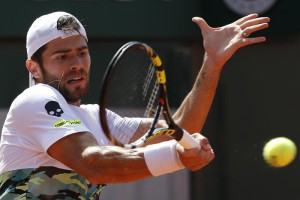 Italy's Simone Bolelli returns in the third round match of the French Open