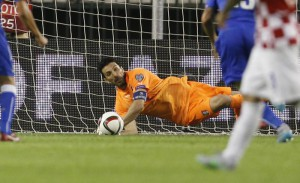 Italy's goalkeeper Gianluigi Buffon saves a penalty shot