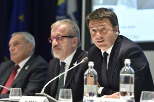 Italian Premier Matteo Renzi (R) speaks during the Italian-Latin American and Caribbean Conference