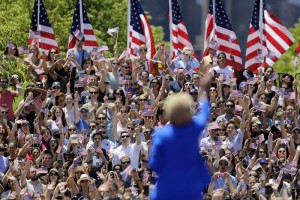 Hillary Rodham Clinton waves to supporters Saturday