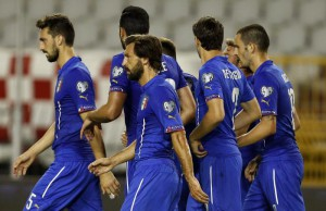 Italy players celebrate their equalizing goal