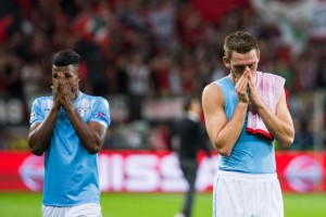 Roms Stefan de Vrij (r) and Keita react after the UEFA Champions League play off second leg match between Bayer Leverkusen and Lazio Rome in Leverkusen, Germany, 26 August 2015.  EPA/ROLF VENNENBERND