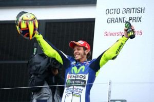 Italian rider Valentino Rossi of Movistar Yamaha celebrates on the podium after winning the MotoGP race of the British Motorcycling Grand Prix at Silverstone race track, Northamptonshire, Britain, 30 August 2015.  EPA/TIM KEETON