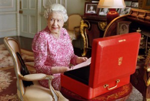 This photo made available on Tuesday Sept. 8, 2015, shows Britain's Queen Elizabeth II taken July 2015 and released by Buckingham Palace to mark the Queen becoming the longest reigning British monarch. The photograph, by Mary McCartney, shows The Queen seated at her desk in her private audience room at Buckingham Palace in London, with one of her official red boxes which she has received almost every day of her reign and contains important papers from government ministers in the United Kingdom and her Realms and from her representatives across the Commonwealth and beyond. (Mary McCartney/Queen Elizabeth II via AP)
