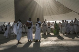 "Muslim pilgrims walk after casting stones at a pillar symbolizing the stoning of Satan, in a ritual called ""Jamarat,"" the last rite of the annual hajj, on the first day of Eid al-Adha, in Mina near the holy city of Mecca, Saudi Arabia, Thursday, Sept. 24, 2015. (ANSA/AP Photo/Mosa'ab Elshamy)"