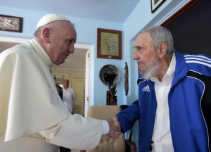 Pope Francis and Cuba's Fidel Castro shakes hands, in Havana, Cuba, Sunday, Sept. 20, 2015. The Vatican described the 40-minute meeting at Castro's residence as informal and familial, with an exchange of books. (ANSA/AP Photo/Alex Castro)