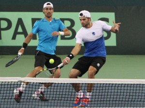 Italy's Simone Bolelli (R) and Fabio Fognini (L) in action against Kazakhstan  Andrey Golubev and Aleksandr Nedovyesov during their match at the Davis Cup tennis tournament in Astana, Kazakhstan, 07 March 2015.  EPA/IGOR KOVALENKO