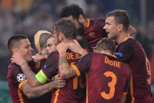 AS Roma's Miralem Pjanic (3L) celebrates with teammates after scoring the 3-2 goal during the UEFA Champions League group E soccer match AS Roma vs Bayer 04 Leverkusen at the Olimpico stadium in Rome, Italy, 04 November 2015. ANSA/MAURIZIO BRAMBATTI