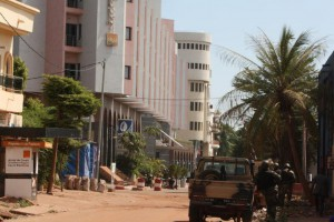 The Radisson Blu hotel, left, that was stormed by gunmen during an attack on the hotel in Bamako, Mali, Friday, Nov. 20, 2015. Islamic extremists armed with guns and throwing grenades stormed the Radisson Blu hotel in Mali's capital Friday morning, killing at least three people and initially taking numerous hostages, authorities said.  (ANSA/AP Photo/Harouna Traore)