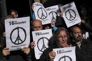 Members of some Spanish trade unions hold up banners that reads, ''November 16. We Are All  Paris'' as they stand during a minute of silence for the victims in Friday's attacks in Paris  in Pamplona, northern Spain, Monday, Nov. 16, 2015. (ANSA/AP Photo/Alvaro Barrientos)