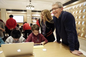 FILE - In this Wednesday, Dec. 9, 2015, file photo, Apple CEO Tim Cook, right, and Apple software engineer and Vice President Cheryl Thomas watch third grade students work on coding at an Apple Store, in New York. You really want kids to learn these building blocks as young as possible and then build on them, said Cook. (ANSA/AP Photo/Mark Lennihan, File)