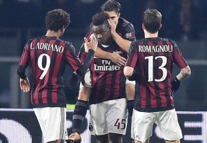 AC Milan's Italian forward, Mario Balotelli (C), jubilates with his teammates after scoring on penalty the goal during the Italy Cup first leg semifinal soccer match US Alessandria vs AC Milan at Olimpico stadium in Turin, Italy, 26 January 2016. ANSA/ALESSANDRO DI MARCO