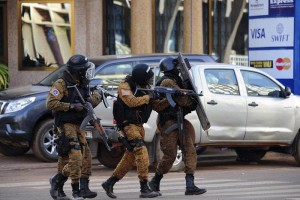 Burkina Faso forces take up positions outside the Splendid Hotel in Ouagadougou, Burkina Faso, 16 January 2016. According to media reports at least 23 people from 18 nationalities have been killed after Islamist militants attacked The Splendid Hotel frequented by many westeners in Burkina Faso. A joint operation by French and Burkina Faso forces freed many hostages. Al-Qaeda in the Islamic Maghreb (AQIM) has claimed responsibility.  EPA/AHMED YEMPABOU