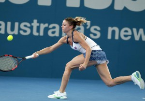 Camila Giorgi of Italy plays a shot in her first round match against Angelique Kerber of Germany during the Brisbane International tennis tournament in Brisbane, Australia, Monday, Jan. 4, 2016. (ANSA/AP Photo/Tertius Pickard)