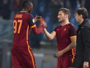 AS Roma's players Francesco Totti (C) and Sadiq (L) during the Italian Serie A soccer match between AS Roma and AC Milan at the Olimpico stadium in Rome, Italy, 09 January 2016.  ANSA/ETTORE FERRARI