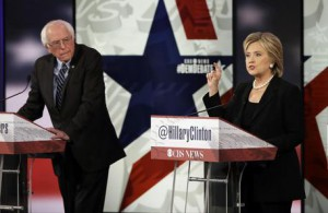 Hillary Rodham Clinton, right, makes a point as Bernie Sanders listens during a Democratic presidential primary debate, Saturday, Nov. 14, 2015, in Des Moines, Iowa. (ANSA/AP Photo/Charlie Neibergall)