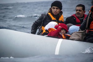 Refugees and migrants on a dinghy arrive from the Turkish coast to the northeastern Greek island of Lesbos, on Friday, Jan. 29, 2016.  (ANSA/AP Photo/Mstyslav Chernov)